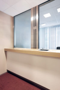 Glazed counter with intercom and wooden tablet cover